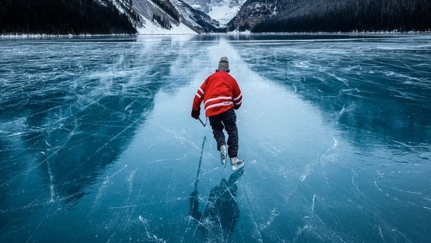 This Banff photographer captures stunning wild ice skating moments in the Rockies