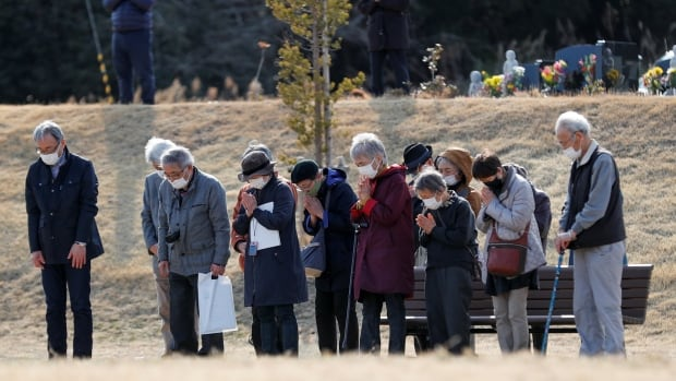 10 years on, Japan mourns victims of deadly tsunami and Fukushima disaster | CBC News