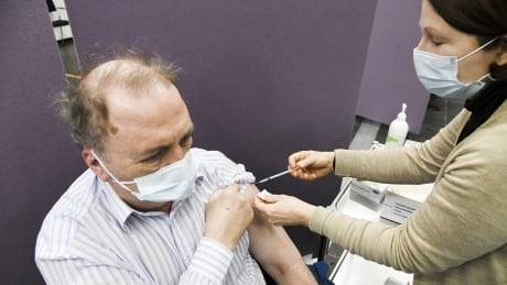 Man being vaccinated against the coronavirus in Vantaa, Finland