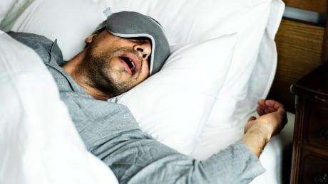 Man sleeping stock photo