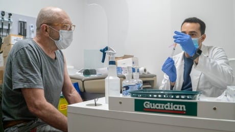 Wayne Millin gets his AstraZeneca COVID-19 vaccine