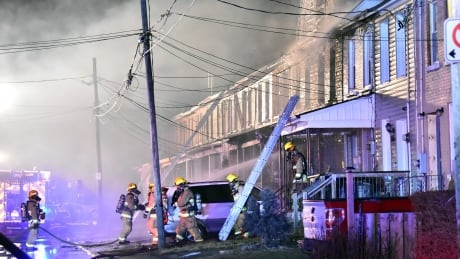 Firefighters dousing residence Olive Avenue