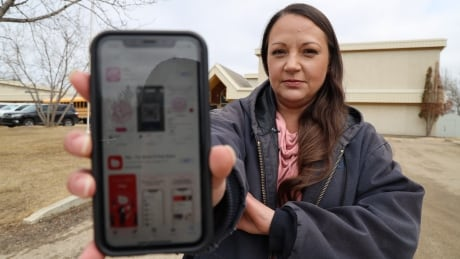 School custodian refuses to download phone app that monitors location, says it got her fired