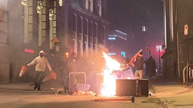 Protesters defy curfew in Old Montreal, setting fires, breaking windows