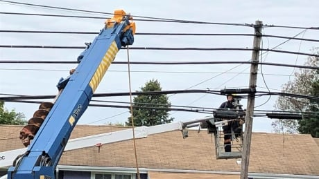 Power line technician at work in Charlottetown