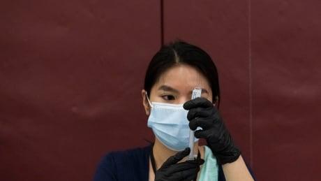 Virus Outbreak Michigan Vaccine