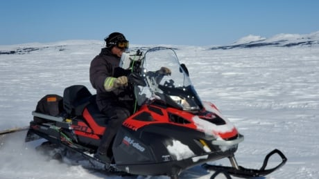 Rex Holwell on snowmobile