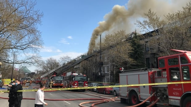 Roof fire displaces residents of 4 Montreal triplexes | CBC News