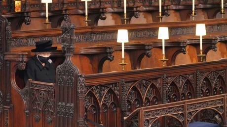 Queen Elizabeth sitting in a pew at St. George's Chapel