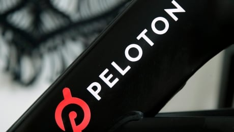 Peloton logo on the side of a stationary bicycle