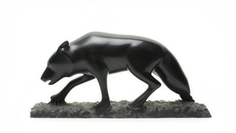 """Wolf Stalking"" carving by John Sabourin"