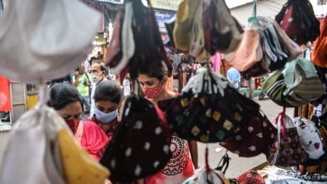 Face masks for sale at a stall in Siliguri, India, during the pandemic