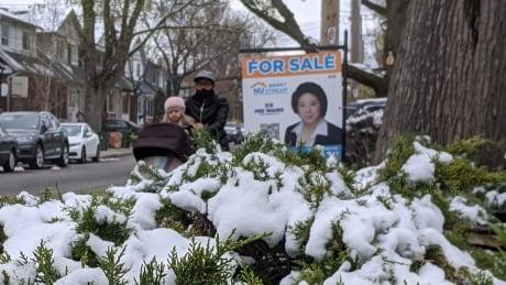 Toronto real estate sign after spring snow