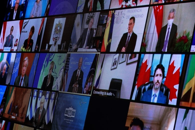 World leaders including Canadian Prime Minister Justin Trudeau appear on screen during a virtual climate summit