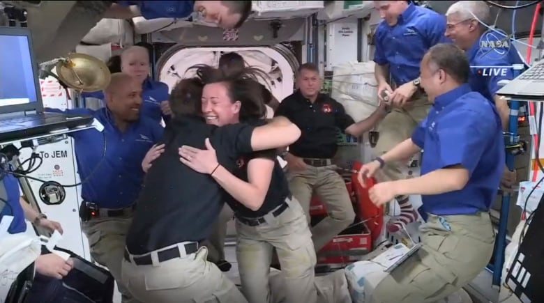 - astronauts greeted by fellow astronauts on board the iss - Space station population grows to 11 after SpaceX capsule transport