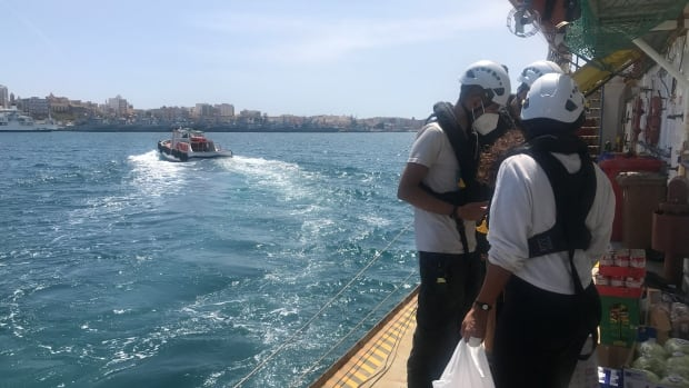 These rescuers want to save refugees fleeing Libya by sea. But they're trapped on shore by red tape