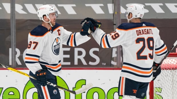 McDavid scores twice as Oilers clinch playoff spot in win over Canucks   CBC Sports