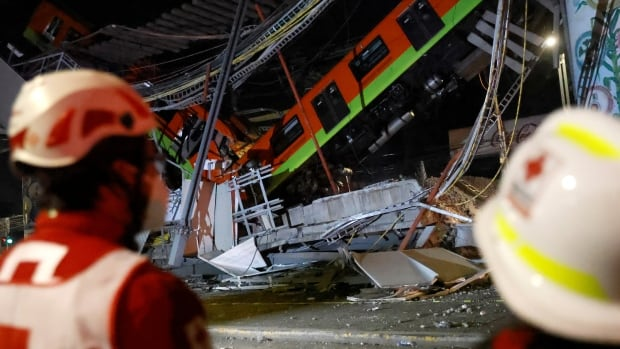 Mexico City metro overpass collapses onto road leaving at least 23 dead