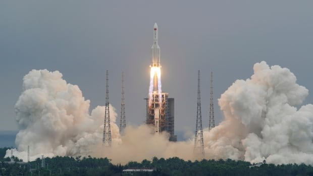 China says there is little threat of rocket causing harm as it returns to Earth