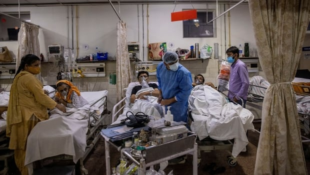 Doctors make life-and-death decisions as India's battle against COVID-19 rages on