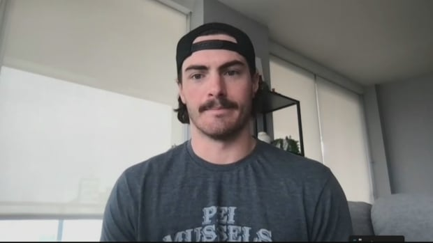 Canucks player Zack MacEwen says COVID-19 is 'no joke' — and he would know