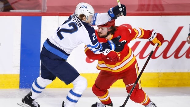 Jets punch ticket to playoffs on milestone night in shutout of Flames | CBC Sports