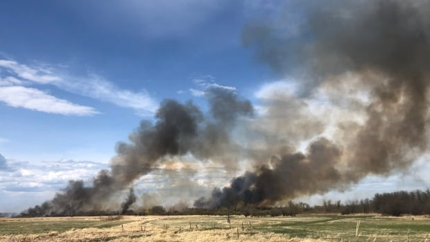 Wildfire burns along Red River during tinder-dry weekend