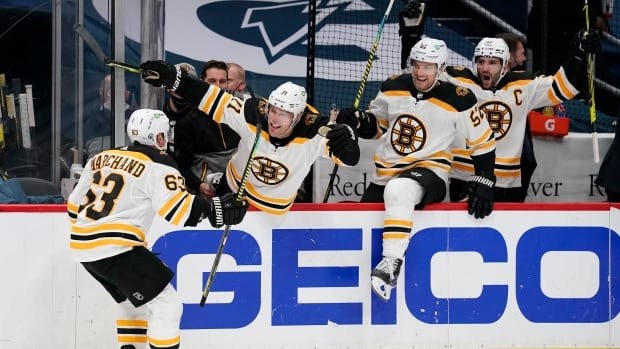 Marchand strikes early in OT to help Bruins level series with Capitals