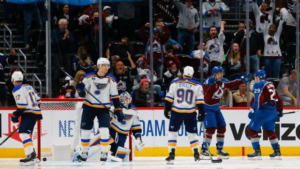MacKinnon powers Avalanche past Blues in series opener