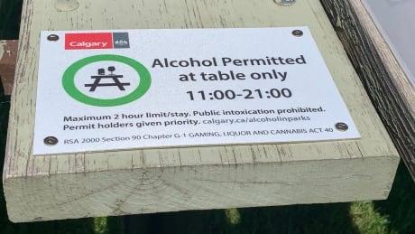 Alcohol sign Calgary park picnic table
