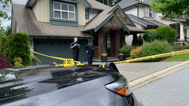 Police tape surrounds Port Moody home of homicide victim Trina Hunt