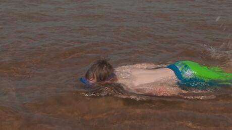 Boy swimming at Brackley Beach, PEI