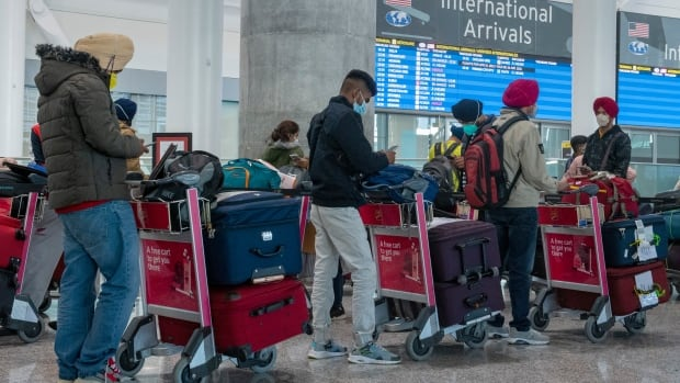 Calgarians waiting to reunite with family members are struggling as India travel ban extended