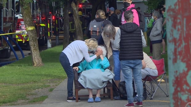 Neighbours carry elderly woman down 15 flights of stairs during Vancouver highrise fire | CBC News