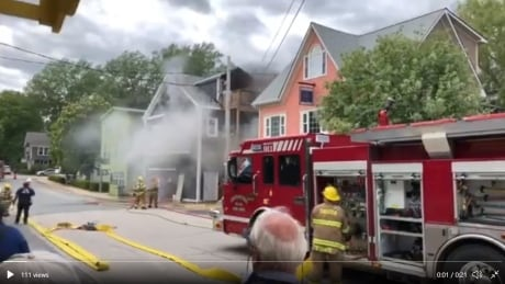 Smoke billows out of the Chester Playhouse building Friday.