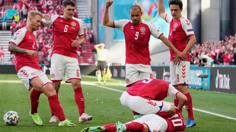 Denmark's Christian Eriksen 'stable and awake' after collapsing during Euro 2020 match | CBC Sports