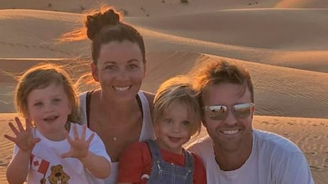 Katie Gibson, her husband Ben and 3-year-old twins Nash and Brooklyn in Abu Dhabi