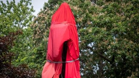 Kingston sir john a. macdonald statue tarp protest