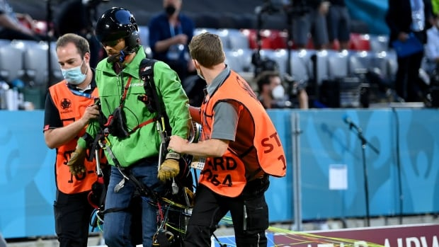 Multiple fans injured by parachuting protestor at Euro Cup