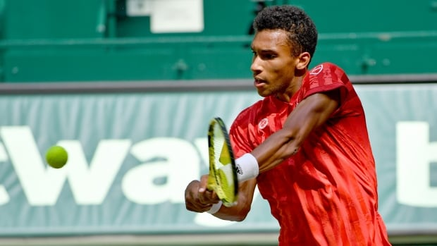 Canada's Auger-Aliassime shocks Federer on grass in Wimbledon tune-up