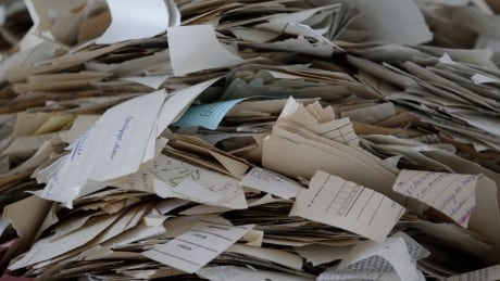 File photo of picture and paper fragments of Stasi records