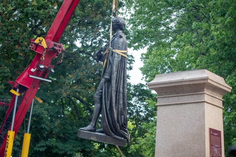 Statue of Sir John A. Macdonald in Hamilton, Ont., covered as Indigenous community calls for it to come down