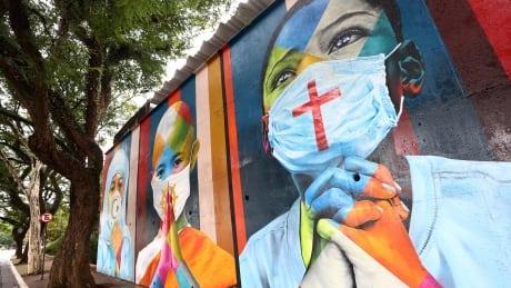 COVID-19 mural by Eduardo Kobra, as seen in Sao Paulo, Brazil