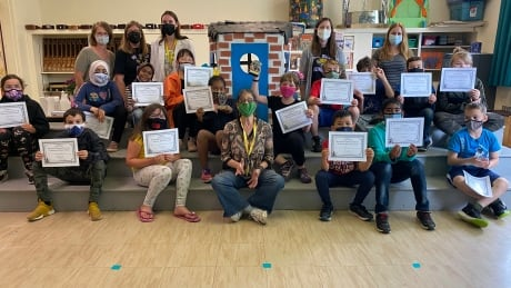 St. Jean elementary class with drama festival trophies