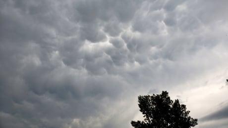 Storm clouds Alberta tornado warning thunderstorm weather