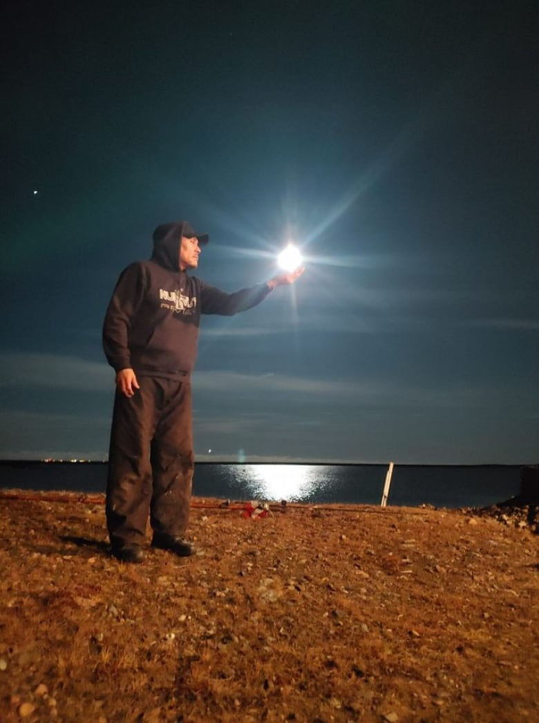 man with moon in arviat
