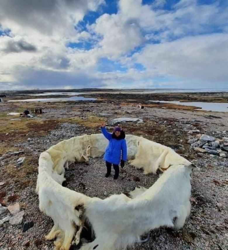 inuk with polar bear hides