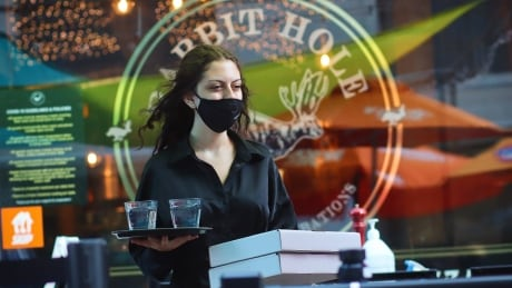 pandemic server covid-19 restaurant patio worker mask ottawa