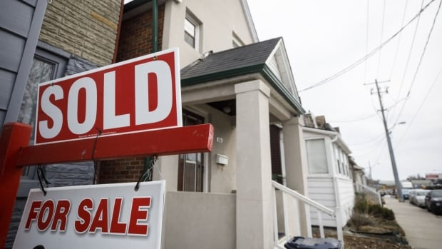 Housing market cooldown continues as sales, prices way up from last year but down from last month | CBC News