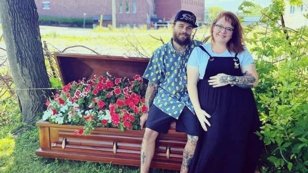 St. Catharines woman put a coffin full of flowers on her front lawn — and someone complained